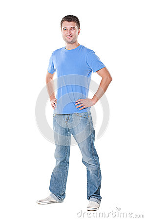Man in blue t-shirt standing over white