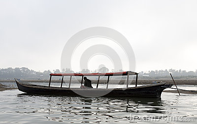 Man on Boat Editorial Stock Photo