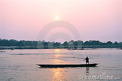 Man on boat at sunset, Chitwan Nepal
