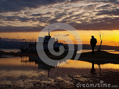 Man and a boats in sunset