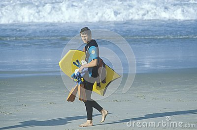 Man with boogie board Editorial Stock Photo