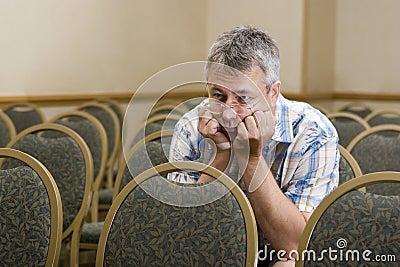 Man at a boring conference
