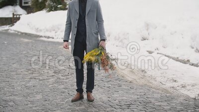 Man with a bouquet of flowers. Man with a bouquet of yellow flowers stock video footage