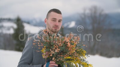 Man with a bouquet of flowers. Portrait of a man with a bouquet of flowers stock footage