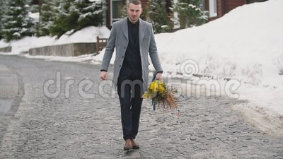 Man with a bouquet of flowers. Man with a bouquet of yellow flowers stock video
