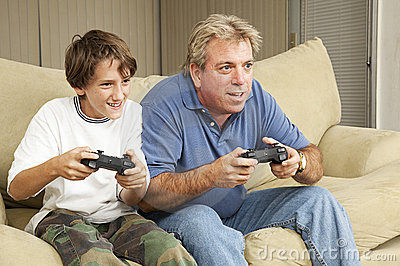 Man and Boy Play Video Games