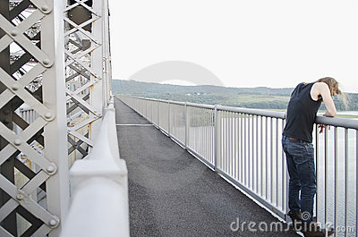 Man on bridge contemplating suicide