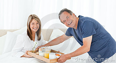 Man bringing breakfast to his wife