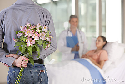 Man bringing flowers to patient
