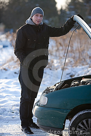 Man with broken car in winter