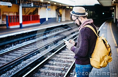 Man In Brown Hoodie Standing In Front Of Train Railway Free Public Domain Cc0 Image