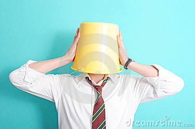 Man with bucket on his head