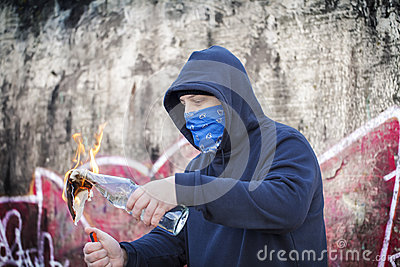 Man with burning Molotov cocktail