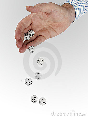 Man in business shirt with tumbling dice
