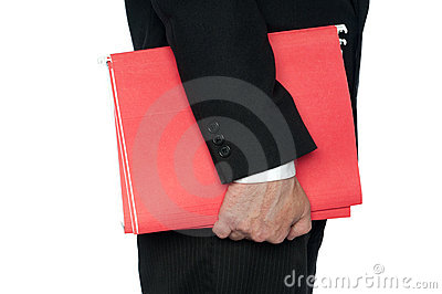 A man in a business suit red file folders