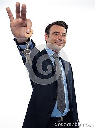 Man Businessman realtor teasing holding keys
