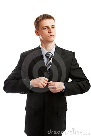 Man buttons a suit