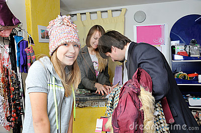 Man buying clothes to young girl