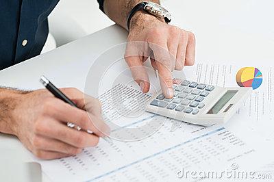 Man Calculating Finance