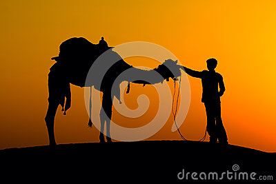 Man and camel silhouette at sunset, Jaisalmer - India