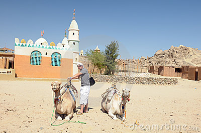 Man with camels in desert