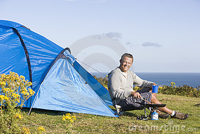 Man camping outdoors and cooking