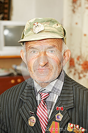 Man in cap with medals