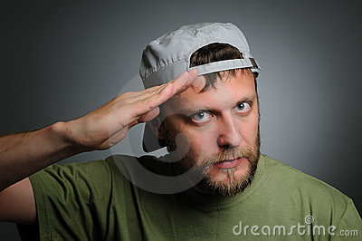 A man in a cap salutes