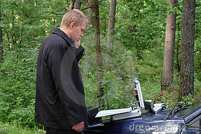 Man at the car in a wood