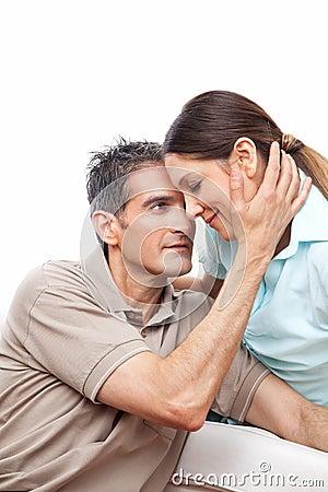 Man caressing woman