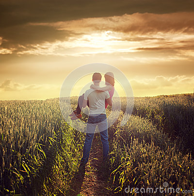 Free Man Carries Woman At Summer Field In Sunset Royalty Free Stock Photos - 38206098