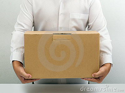 Man carry brown paper box