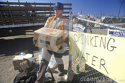 A man carrying drinking water away Editorial Image