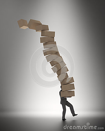 Man carrying a pile of boxes