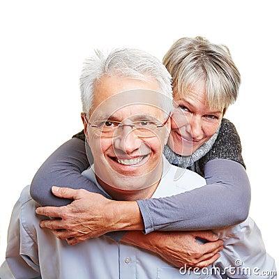 Man carrying senior woman piggyback