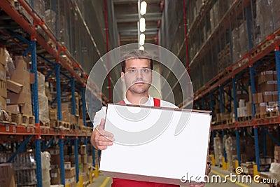 Man carrying white box