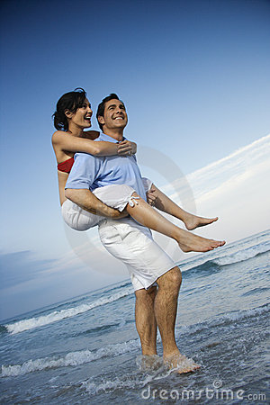 Free Man Carrying Woman Piggyback At Beach. Royalty Free Stock Images - 2038269