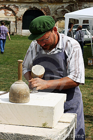Man carving in stone Editorial Image