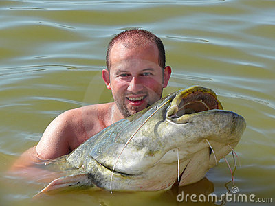 A man with a catfish