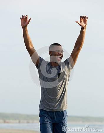 Free Man Celebrating With Arms Raised Up Stock Photo - 45905900