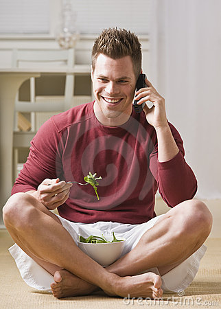 Man With Cell Phone and Salad