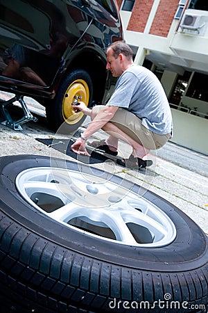 Man changing his car tyre