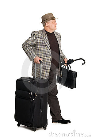 Man in a checkered suit and luggage