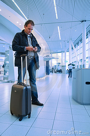 Man checking email on airport