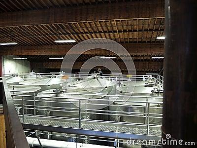 Large metal tanks in wine cellar
