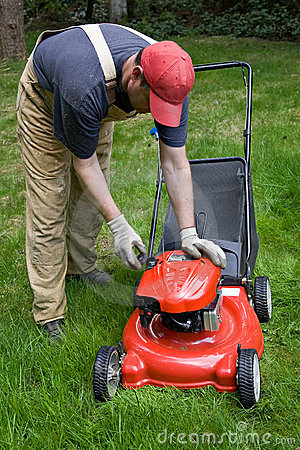 Man checking gas powered lawn mower