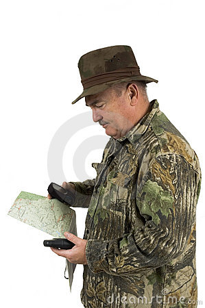 Man checking position with GPS and maps