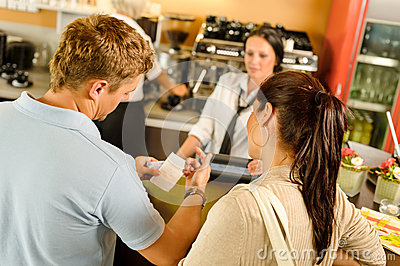 Man checking receipt at cafe payment