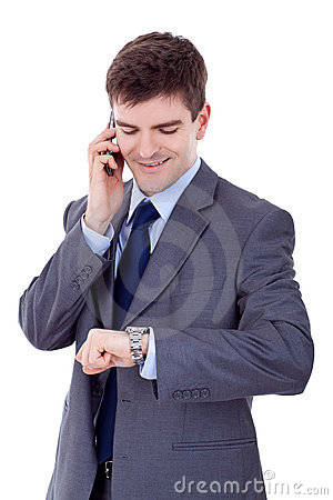 Man checking time while speaking on cellphone