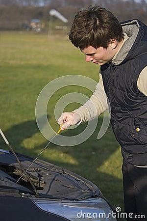 Man checks oil level